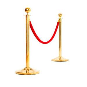 Золотистый столбик с красным канатом